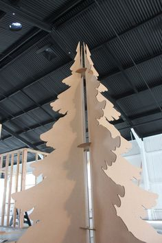 I cannot get enough of this cardboard Christmas tree. Looks phenomenal! Doesnt even need lights. Perfect for a store window, lobby, Christmas display or my living room. (where this baby is going) The cardboard Christmas Tree is 70in tall (just under 6ft ) and is made from 1/8 in recycled cardboard cut with a knife blade. (so it wont stink like cardboard cut with a laser) Its super easy to put together (2 people - 3 minute) would be really cool if you painted it with gold or silver spray…