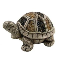 Ceramic turtle sculpture with stone mosaic detail.