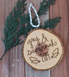 This is very cute. Would be nice for a first Christmas gift or even a 10+ years together gift. :: Custom Tree Slice Christmas Ornament by Savvie Design Co.