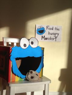 Cookie Monster bean bag toss game (a's Sesame Street 2nd birthday party) - make box to look like a fish bowl and use fish bean bags!