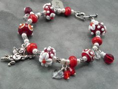 Whimsical Valentine Gift -  Lampwork Beaded Bracelet with Cherub and Love Charms. $53.60, via Etsy.