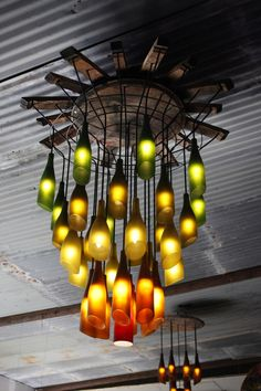Love this recycled wine bottle chandelier (Has other wine bottle recycling ideas in the post too - 20 in fact! Recycled Wine Bottles, Wine Bottle Art, Lighted Wine Bottles, Bottle Lights, Wine Bottle Crafts, Bottles And Jars, Recycle Bottles, Wine Bottle Lighting, Beer Bottles