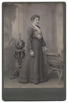 Fig.9 Cabinet print, c.1901-4 (Domestic servant) - click to enlarge. Imposing Victorian backdrops may be combined with ornate, art nouveau-style... article to date photo by studio setting