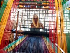 A Maguindanao woman weaves traditional garment known for its rich color and artistry at the AL Jamelah Weaving and Sewing Enterprise in Cotabato City.   Bill to revive Philippine garments industry refiled in US Congress   Inquirer Global Nation