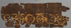 971 AD, Mammen, Denmark. Embroidered border on textile fragment which is believed to belong to the Mammen Man's cloak or tunic. Red wool embroidered with red, blue and yellow thread.
