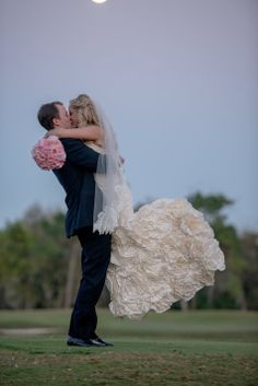 Adorable Bride and Groom Embrace | Tina Sargeant Photography | TheKnot.com