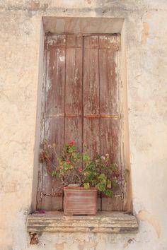 Ancient window. Crete, Greece.