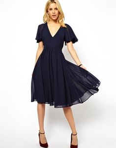 I love everything about this dress (except the back... I NEED to wear a bra) -- the navy color, the flutter sleeves, fitted v-neck bodice and flowy skirt. LOVE. Too bad they are sold out of my size.