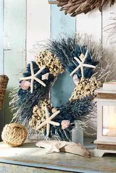 Beach House Decor - Preserved seaside flowers and starfish are arranged in a stunning wreath true to the coastal style. This handcrafted roundabout is exclusive to Pier 1, and it's perfect for your mantel, doorway, picture window or tabletop.