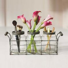 Perfect for your elegant bath, this set of three vintage jars in a rack lends a rustic-industrial bath a timeworn character. Store and display cotton balls, toothbrushes, flowers, and small grooming items in the jars.