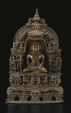 A COPPER ALLOY JAIN SHRINE WESTERN INDIA, RAJASTHAN, CA. 16TH CENTURY Height 9 ⅛ in. (23.2 cm)