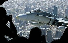 The crew of an RAAF C17asked the pilot of an RAAF F/A-18 hornet to come close for a photo @ cargo bay door.