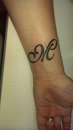 Letter M tatoo on wrist