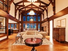 """Craftsman Living Room with Chandelier, Gail's accents """"luxe"""" end table, Glass panel door, Cathedral ceiling, Hardwood floors"""