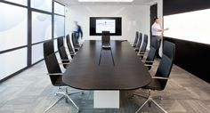 Impressive board room with large screens and walls to brainstorm on. Regulatory Finance Solutions in Swindon office designed by Interaction.