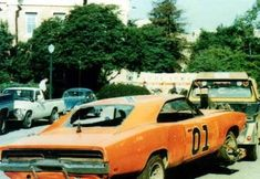 Looking at the hood standing up my best guess is that it is from the jump over the fruitstall on Midwest Street. The one where Enos and Rosco both jump and . Duke Vs, Bo Duke, Sorrell Booke, Denver Pyle, James Best, Junkyard Cars, Dukes Of Hazard, Catherine Bach, Smokey And The Bandit