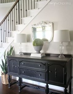 Sideboard table along stair wall. Don't really like style of sideboard