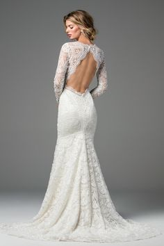 Delicate yet decadent, Anastasia is an intricate masterpiece. Cybele Lace, Deryn Trim and Illusion Tulle make the statement all brides hope for on their big day. Lace sleeves and a deep V-Neck perfectly compliment this backless gown to create a stunning silhouette. Also available unbeaded as Style 18117P. Sweep train.