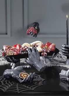 Display all your frightening finger foods at your Halloween party this year in the Creepy Hands Serving Tray that sits atop four stone-like creepy hands.
