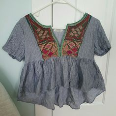 American Eagle crop top this top is perfect for everything. it has an adorable tribal print design on it along with the flowing bottom. American Eagle Outfitters Tops Crop Tops