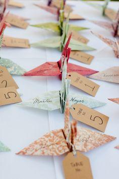 marcadores para las mesas con el nombre de los invitados