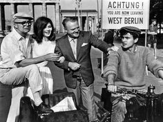 """Billy Wilder, James Cagney, Pamela Tiffin and Horst Buchholz on the set of """"One, Two, Three"""" (1961)"""
