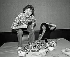 """ Angus Young and Bon Scott at lunch, 1977 """