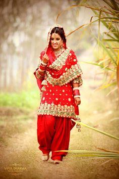 Indian bride wearing bridal lehenga and jewelry. #BridalHairstyle #BridalMakeup #PunjabiBride