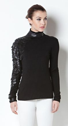 One Hottie Mama  - Leather Leaflet Scale Sleeve Turtleneck Top, $62.90 (http://stores.onehottiemama.com/leather-leaflet-scale-sleeve-turtleneck-top/)