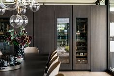 Poliform Artex in grey stained oak, integrated appliances from Gaggenau and Miele, tabletop in composite stone. Grey Stain, Bespoke Kitchens, Tabletop, Liquor Cabinet, Kitchen Design, Appliances, Studio, Stone, Furniture