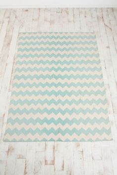I could paint a boring old rug and customize the colors. In my living room maybe? Navy and tan? Black and white?