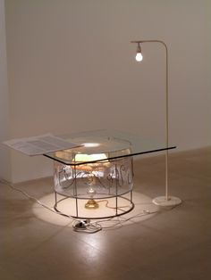 Untitled, 2008 Josef Strau mixed media table, lamps, inkjet printer poster dimensions variable