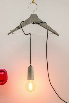 This concrete coat hanger lamp is super cool and super fun. Adds some style to the home, office or wherever. #ad #concrete #lamp #coathanger #cement #homedecor #decoration