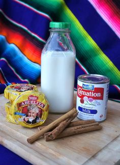 I usually heat the milk and let it simmer with some Mexican vanilla and cinnamon sticks and then add the chocolate to it and use a whisk to beat until it is thick and frothy. Cinnamon can be added as well :)   For baby shower-I would triple or quadruple recipe then place in a crock pot.