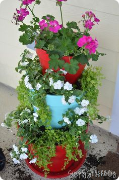 Front porch makeover, stacked potted plants