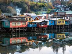 10 best places in Chile - South America's fifth-largest island is home to waterfront houses on stilts, wild national parks, dense forests, and iconic wooden churches, 16 of which are UNESCO World Heritage sites. Beautiful Islands, Beautiful Places, Iglesia San Francisco, Visit Chile, House On Stilts, World Heritage Sites, Where To Go, South America, Traveling By Yourself