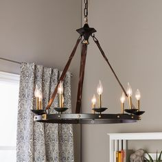 rustic meets in this beautiful cavalier chandelier the frame showcases a large black metal