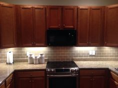 Champagne Glass Subway Tile Kitchen Backsplash Lighting Decor With Brown Maple Cabinets