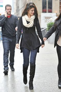 #SelenaGomez: Black knit coat with skinnies and tall boots. An adorably awesome outfit for the fall! Shop #DMLooks at DivaMall.tv