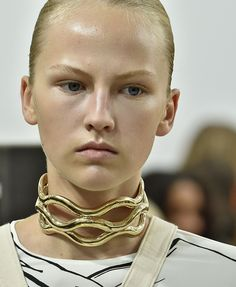 Gold choker necklace at J.W.Anderson
