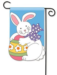 """BreezeArt Breeze Art EASTER BUNNY Applique Garden Mini Flag by BreezeArt. $11.95. Machine washable, cool iron on polyester setting. 100% All-Weather Polyester. Fade and Mildew Resistant. Flag stand sold separately. EASTER BUNNY BreezeArt® Appliqué Garden Flag Energize your garden with color, as this bunny holds a brightly colored Easter egg and dons a big purple bow. This premium flag is guaranteed for 1 year against weather-related failure.Item ID: 34049 ; Size: 12.5"""" x 18""""..."""