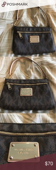 "[Michael Kors] Monogram Small Purse Excellent condition! No flaws except for two tiny scratches on the gold emblem. Michael Kors dark brown monogram leather bag. 100% authentic. Can be used as a wristlet or small purse. Has inside pockets and an outside pocket, zipper close. Measures 8"" x 5"". Open to reasonable offers only, no trades or lowballs. Michael Kors Bags Shoulder Bags"
