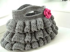 Crochet ruffle purse! How adorable for a little one who loves bags to carry toys around ing! :))
