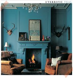 turquoise wall, antler decoration, fireplace  It's funny and hypocritical of me at the same time to hate the idea of hunting, but strangely attracted to taxidermy, hides and furs