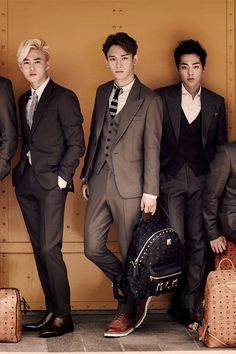 EXO x MCM- Kai's arm on the left, Suho, Chen, Xiumin, and Baekhyun's are on the right