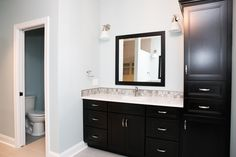 Vanity with linen unit in a Smoke finish with a light top to make it really POP!