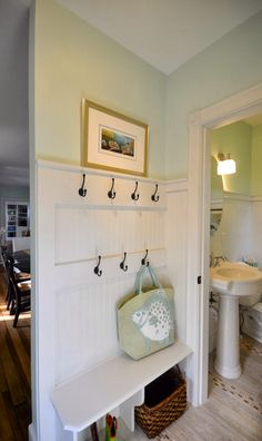 Bead board/ bench and hooks...   I could probably do this myself in our back entryway...