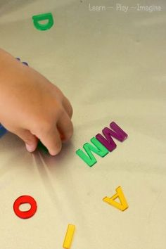 Matching letters and boosting fine motor skills with this sensory activity to practice letter recognition and sounds.