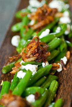 Green beans with shallots and goat cheese crumbles. Have made this and it is delicious.