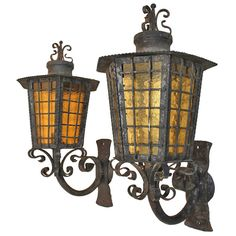 Antique Pair of Large French, 1940 Wrought Iron Outdoor Sconces | From a unique collection of antique and modern wall lights and sconces at https://www.1stdibs.com/furniture/lighting/sconces-wall-lights/